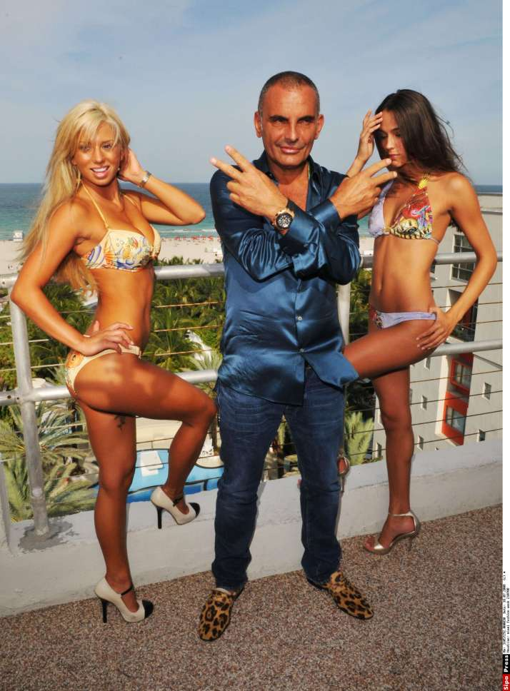 Designer Christian Audigier and models Sara Balint and Sabrina Careja at the Ed Hardy Swimwear 2009 collection during Mercedes-Benz Fashion Week at the Raleigh Hotel  Miami, Florida - 18.07.08 Credit: Lester P. Jones / WENN/miami_fashion_week_210708.miami_fashion_week_2/0807210428