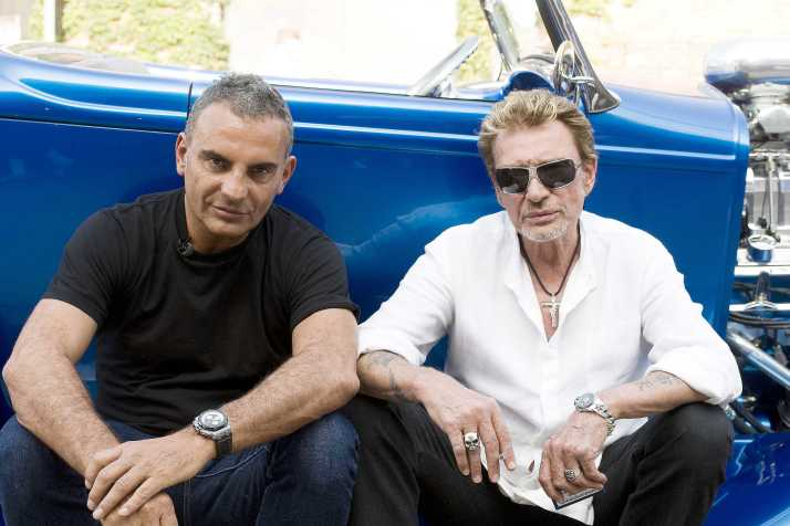 Singer Johnny Hallyday (r) and fashion designer Christian Audigier (l) treat themselves to a ride in vintage Hot Rods from Melrose to Sunset Boulevard, before celebrating the designer's 50th birthday. They also went shopping and had a shave at Floyd's barbers. Los Angeles, USA-21/05/2008.