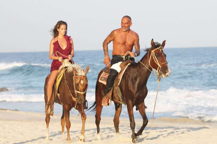 Christian Audigier and girlfriend Nathalie Sorensen enjoy a romantic getaway weekend in Cabo San Lucas, where the couple came to celebrate the Mexican Independence Day. After a nice long walk on the beach, the couple were spotted sharing a kiss and riding along the beach on horseback. Cabo San Lucas, Mexico - 15.09.11 Mandatory Credit: BAC/WENN.com/christian_audigier_160911.audigier_sorensen_09/1109161455